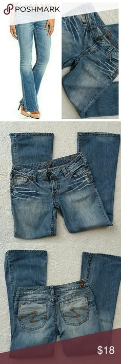 """SILVER FLARE TUESDAY JEANS   SIZE 30 Light wash,  whiskering at the thigh.  A little distressed and a sanded wash. They feel like 100 % cotton.  16.5 """" across the waist.  8 """" from the waist to the crotch.  30 """" from crotch to hem.  10 """" leg opening Silver Jeans Jeans Flare & Wide Leg"""