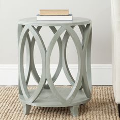 Features:  -Material: Poplar wood.  -Wood content: Pine.  -Capacity: 66 lbs.  Shape: -Round.  Design: -Table.  Style (Old): -Contemporary.  Base Type: -3 & 4 Legs.  Base Material: -Solid Wood.  Top Ma