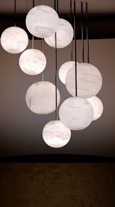 They look like the moon.... beautiful for outside lighting or a room with a beautiful skyline view at night........lustre en albâtre  Harmony10   alabaster chandelier