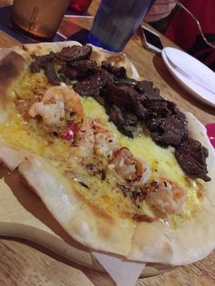 Wagyu beef & Garlic prawn pizza