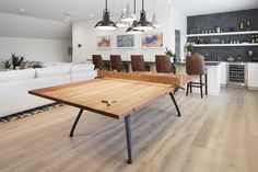 The game room, complete with bar, showcases an industrial-style polished wood and metal ping pong table lit by a makeshift chandelier of warehouse pendants. Ping Pong Room, Table Ping Pong, Small Game Rooms, Small Living Rooms, Pool Table Room, Warehouse Living, Loft, Trendy Home, Decoration