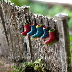 Add whimsy to your fairy garden with a fence adorned with tiny galoshes and hinged gates. Buy it at fairyhomesandgardens.com #GardenGate