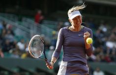 Russia's Maria Sharapova celebrates after winning the first set against United States' Sloane Stephens during their French Tennis Open round...