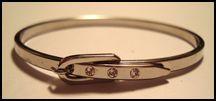 Bangle bracelet that looks like it buckles on.