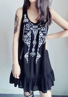 This black embroidered tank dress comes with white embroidered design in front, scoop neck and black floral lace detailing. It also has falbala detailing in bottom hem. | Lookbook Store What's New