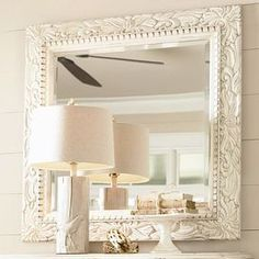 """Mirror with a dentil-molded laurel leaf frame.Product: Wall mirrorConstruction Material: Poplar veneers, hardwood solids and mirrored glassColor: CreamFeatures:Part of the Paula Deen Home Collection Laurel leaf frameworkDimensions: 36"""" H x 36"""" W x 2"""" D"""