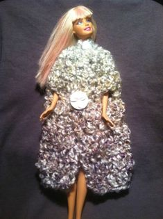 This is a guide about Barbie's crocheted winter cloak. Beautiful doll fashions can be crocheted inexpensively, and make a young girl very happy.