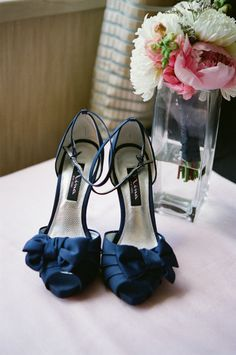 simple dark blue heels and gorgeous pink flowers. Adorable for your wedding day!