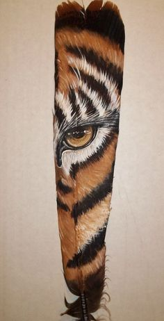 Tiger painted on a feather    ...apparently by Veronica Regan - Google redirected me to Wildlife Collectables, but it must have been sold...