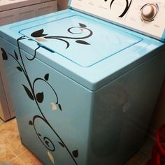 Painted washer with floral vinyl stickers. Can of paint $4, stickers $8. Total cost to decorate $12. For older washer/dryer fix up?