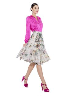 This knee length viscose drapey skirt is decorated with a flowery print. A high waist and hidden closing zip cut into a classic shape for that extra feminine look. Fabric imported from Italy: 97% Viscose 3% Elastane Lining imported from Germany: 57% Viscose 40% Polyimide 3% Elastane Washcare: Dry clean MADE IN EUROPE