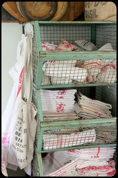 Vintage bins for linens... Small hooks on side to store bags, washcloth, hand-towel, dish-towel, etc. (whole house is adorable!!)