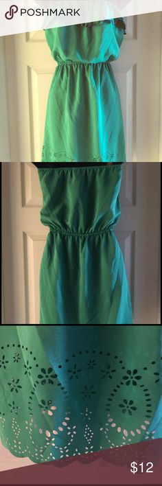 """SNAP Strapless Dress with Laser Cut Detail This strapless dress is a beautiful green color with ruffle at bust with blue trim, scalloped hem at bottom with 4"""" of laser cutout detail. Belt loops and elastic at top and waist. Snap Dresses Strapless"""