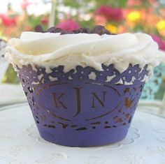 Monogrammed cupcake wrapper.  Love, love, love it for bridal showers (use the maiden monogram) or at weddings (use the couples monogram).  $1.40