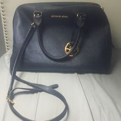 *AUTHENTIC* Navy Michael Kors Bag Very popular style! Navy with gold hardware. This bag can be held on your arm or you could use the long strap on your shoulder. The matching wallet is also for sale! Michael Kors Bags Shoulder Bags