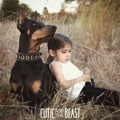 Cutie Siena and her Doberman