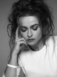 This is exactly what my hair looks like when I get up...why can't I just live with it? Oh yeah...She's Helena Bonham Carter and I'm not.