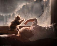 Elena Shumilova's magical, wintry photography: Boy and kitten