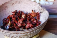 Chapulines? Small grasshoppers that are toasted with garlic and lime, and seasoned with sal de gusano, which is worm salt, a combination of powdered chile, salt and gusano - a caterpillar that lives off the agave plant.