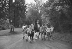 Former First Lady Eleanor Roosevelt walks with children en route to a picnic, 1948.