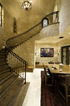 An elegant sweeping staircase descends to a Tasting Room & Wine Cellar, along with a Home Theater. Tuscan luxury at its finest.