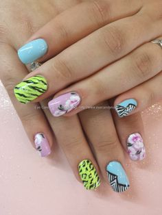 Multicoloured freehand nail art with one stroke flower nail art