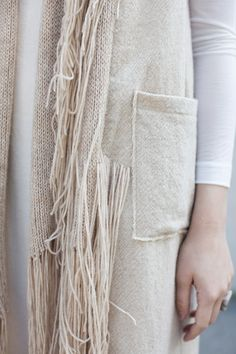 Textiles for Fashion - fringe coat with woven & knitted panels for texture & contrast; close up fashion detail // Correll Correll