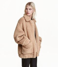 Beige. Short coat in soft pile with a collar, concealed zip, patch front pockets, and elastication at cuffs and hem. Lined.
