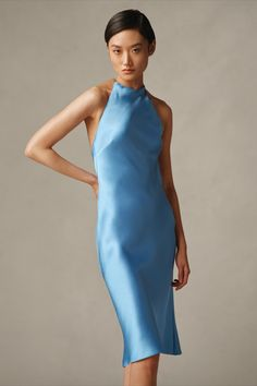 """The Asher Silk Halter Cocktail Dress beautifully elevates a timeless slip dress silhouette with an open back, cutaway shoulders, and a halter neckline that secures with a palladium-plated omega-chain collar engraved with """"RL"""" at its clasp closure. #RalphLauren Simple Elegance, Elegant, Ralph Lauren Collection, Dress Silhouette, Slow Fashion, Sustainable Fashion, Chic, High Neck Dress, Glamour"""