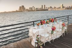Tablescape on the San Diego bay! Love every detail from this vibrant, colorful  nautical themed table top wedding inspiration! This shoot takes place at the Coronado Island Marriott - for more ideas and wedding & engagement photography inspiration, check out my blog! www.britjaye.com/blog —San Diego Wedding & Engagement Photography  #sandiegoengagementphotography #weddinginspiration #weddingphotos #weddingphotographer