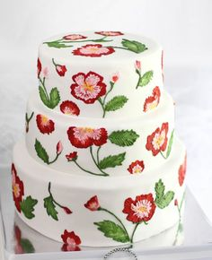 Beautiful embroidery inspired red floral wedding cake