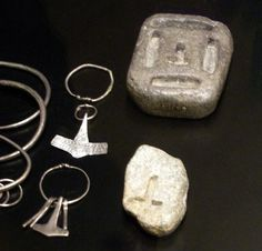 Thor's hammer amulet and casting molds out of stone. Displayed in the National Museum of Denmark in Copenhagen.