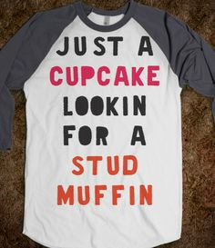 I want! Someone buy this for me. :) I wear a small and I want it in black :) Just A Cupcake Looking For A Stud Muffin -Baseball Tee-