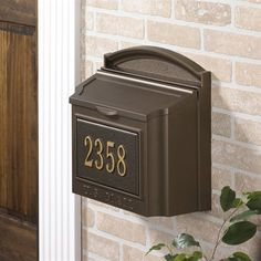This is the Whitehall 16104 personalized wall mount mailbox and custom address plaque in french bronze. This wall mount mailbox makes a big first impression to any home. The extra large capacity mailbox holds over-sized envelopes and magazines. Wall Mount Mailbox, Mounted Mailbox, Residential Mailboxes, Security Mailbox, Mailbox Numbers, House Numbers, Personalized Plaques, Whitehall Products, Address Plaque