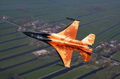 We can't think for anything more Dutch than the Orange Lion over typically Dutch grounds. The first time the new demo F-16 (2009) was revealed to the world was when landing at Volkel air base. We had the privilege to take photo's prior to that (F9, 1/1000s, ISO 400, 90mm).  Photo: Aoo Eric Vorstenbosch, Photoflight Soesterberg - RNLAF