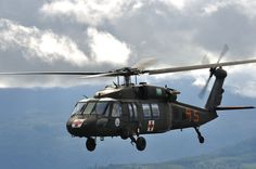 https://flic.kr/p/DkK98b | Cougar 9-5 | Cougar 9-5, of the Washington Army National Guard, joins in formation with Wolf 0-8, of the Colorado Army National Guard, after moving several Hotshot teams to new locations around the fires raging in the area around Lake Chelan, WA.  After the aircraft land and fuel, they will re-attach their Bambi Buckets and continue fire-fighting efforts from the air, in concert with ground teams and several other aircraft.