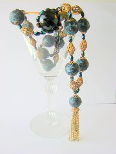 This lovely #vintage tassel necklace, presented by JoysShop for consideration, features a long strand of variegated blue composition beads, glass aurora borealis beads, and ... #jewelry #vjse2