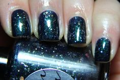 A dark, shimmery blue green with gold glitter.
