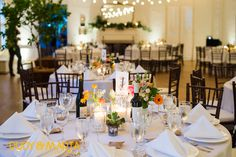 reception tables were filled with candles, vintage bottles, mercury glass votives, and milk glass vases filled with a variety of flowers of orange, pink, ivory, yellow, mixed with ferns, succulents and greenery.