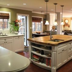 Here's a very versatile paint colour that will easily make the transition between spring, summer and fall. White cabinetry and the thick stone island countertop complete the look. Just add accessories.