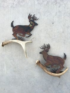 HIGH COUNTRY DESIGNS ANTLER ART This Beautiful Pair of Rustic Wall Art is made of Authentic Deer Antler, and Precision Cut Metal. Enhance your decor with the addition of this extraordinary and decorat