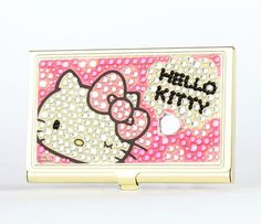 Hello Kitty Card Case Glitter (14241-201303): Be ready to connect and store your business cards with this Hello Kitty Busniess Card Case. This golden color steel case features a glass and acrylic rhinestone design with Hello Kittys face! Steel, Acrylic, Glass $28