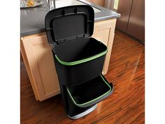 recycle on top in small bin and garbage in larger bin on bottom