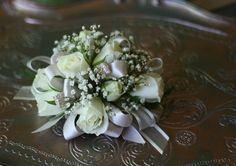 Sweet wristlet of white spray roses, baby's breath and blush ribbon. #promflowers #wristlet