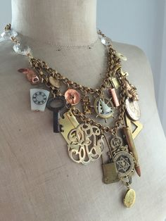 This fabulous steampunk charm statement necklace is jam packed with genuine vintage and antique charms, momentos and curios and is dedicated to the memory of our Grandfathers. By rebecca3030.etsy.com