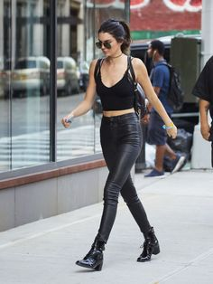 Out in New York City wearing a black crop top by Are You Am I, Unravel black leather pants and Louis Vuitton boots.