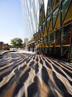 Glass triangles animate facade of Wingårdh's auditorium for Karolinska Institutet.