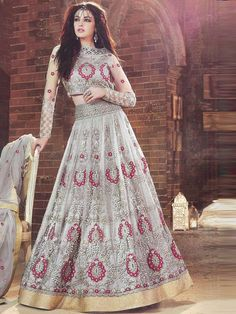 Deviating from the conventional red and maroons, this aesthetically designed grey lehenga outfit with hints of red and gold colour embroidery makes it a suitable choice for modern day brides seeking experimentation in their wedding day look.