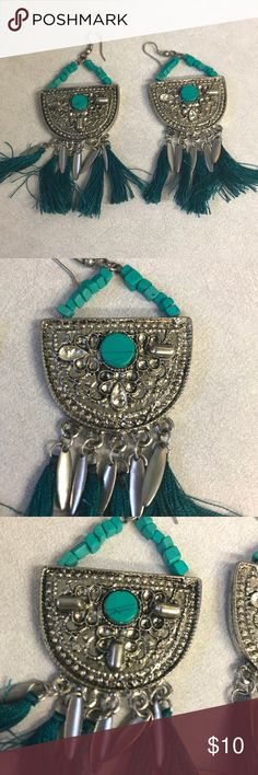 Statement Earrings These have a lovely retro/ boho vibe to them with an almost art deco silver base and lovely turquoise accents. You can pair them with a date night dress it a club night crop top! Either way, they will make you stand out. Jewelry Earrings