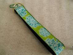 Blue flowers on green key chain fob wristlet on black by DelsWorks, $6.00  https://www.etsy.com/listing/128634820/blue-flowers-on-green-key-chain-fob?ref=sr_gallery_27&ga_search_query=green%2C+black%2C+blue+fabric&ga_view_type=gallery&ga_page=13&ga_search_type=all